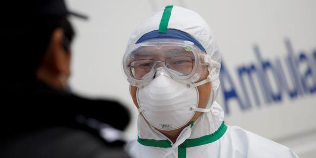 Phận người Trung Quốc chết vì virus corona: Không được tổ chức đám tang, người nhà không được phép nhìn mặt lần cuối và tiếp xúc cho đến khi hỏa thiêu xong - Ảnh 1.