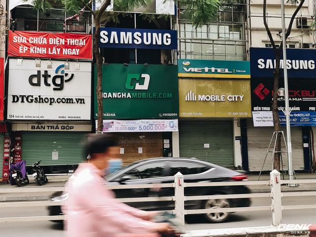 Cửa hàng kinh doanh điện thoại lớn nhỏ đóng cửa vì dịch, chuyển sang bán online - Ảnh 3.