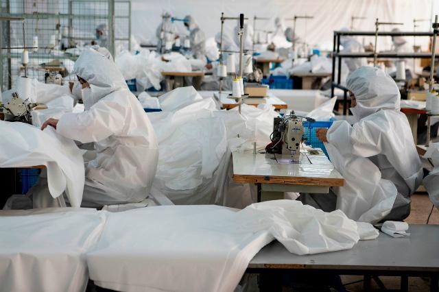 Ngành dệt may toàn cầu mất 1,5 tỷ USD do dịch bệnh nCoV - Ảnh 1.