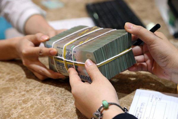 Có tình trạng doanh nghiệp thua lỗ gây áp lực cho hoạt động ngân hàng - Ảnh 1.