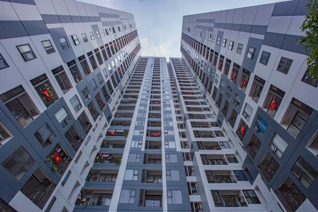 Giá chung cư ven đô Hà Nội chạm 60 triệu đồng một m2 - Ảnh 1.