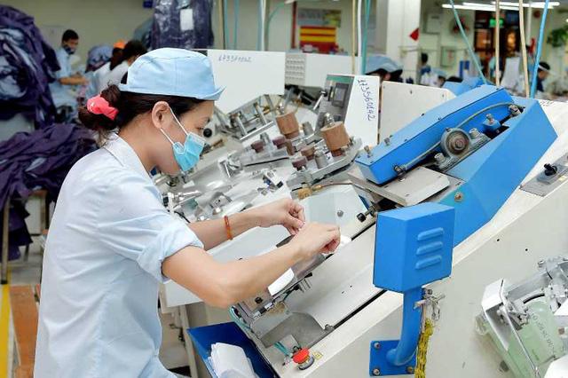 Dệt may đặt mục tiêu xuất khẩu 39 tỷ USD trong năm 2021  - Ảnh 1.