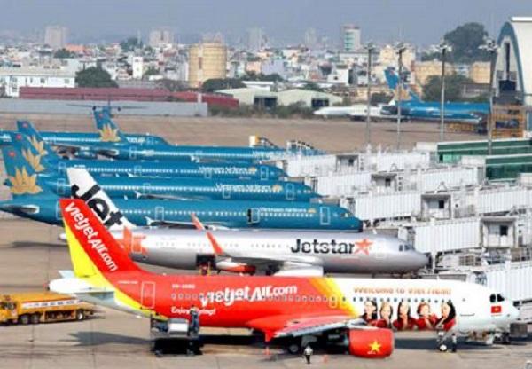 Giá vé máy bay nội địa dịp Tết tiếp đà giảm mạnh - Ảnh 1.