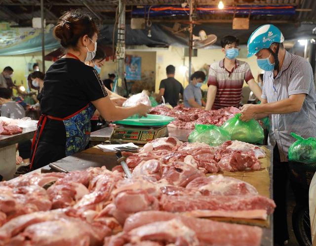 Giá lợn hơi có nơi dưới 40.000 đồng/kg - Ảnh 2.