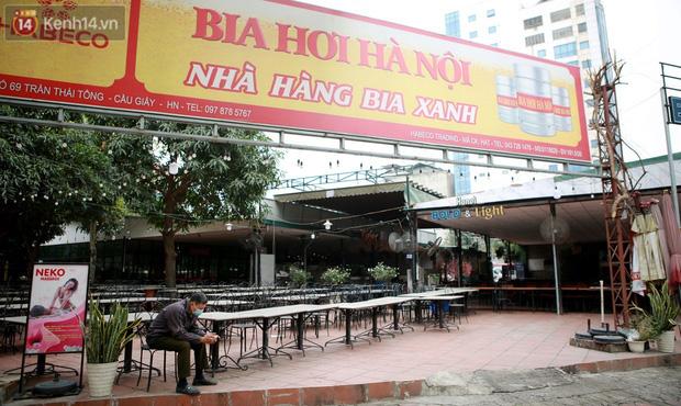 Ảnh: Hàng quán Hà Nội nơi đìu hiu, nơi phải đóng cửa vì ảnh hưởng của dịch Covid -19 - Ảnh 4.
