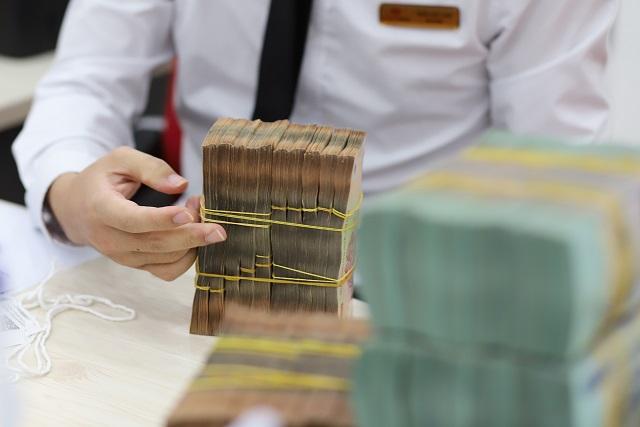 Ngân hàng xin tăng vốn mùa họp cổ đông - Ảnh 1.