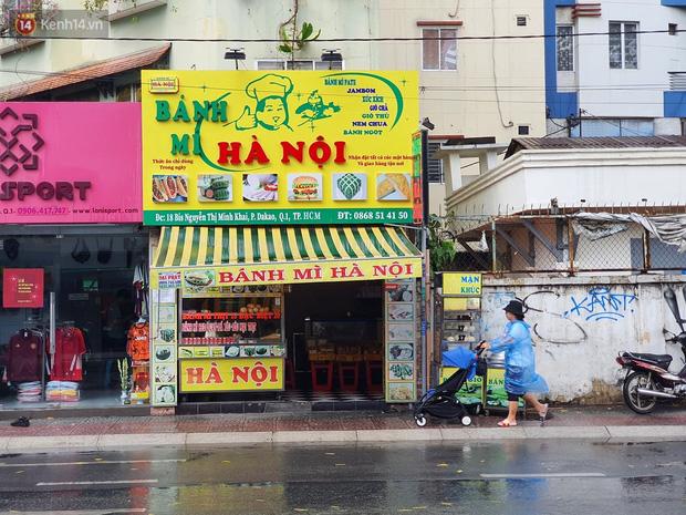 ẢNH: Mưa lớn bất ngờ vào giữa trưa, người Sài Gòn được giải nhiệt sau những ngày nắng nóng oi bức - Ảnh 20.