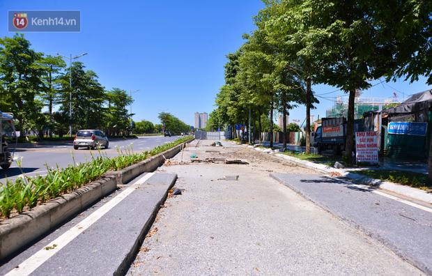 Ảnh: Đại lộ nghìn tỷ Chu Văn An nhếch nhác rác thải, vật liệu xây dựng sau 7 năm thi công - Ảnh 2.
