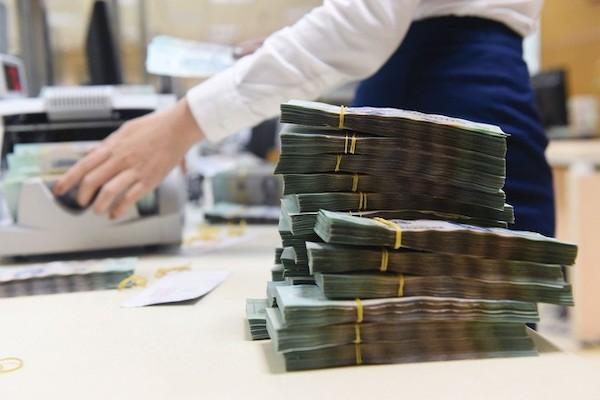 Cần chính sách gỡ vướng cho xử lý nợ xấu - Ảnh 1.