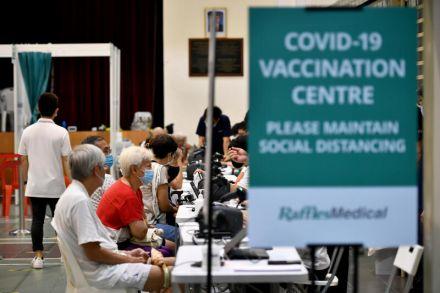 """Từ """"miễn đăng ký"""" đến """"gõ cửa từng nhà"""" để phủ sóng vắc-xin Covid-19 - Ảnh 4."""