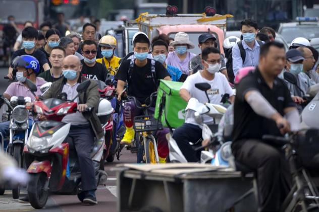 Người trẻ Trung Quốc bỏ phố về quê 'nằm duỗi' - Ảnh 1.