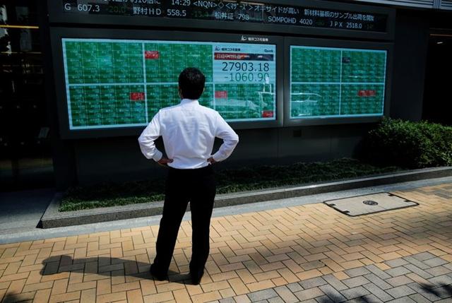 Lo sợ Covid-19, khối ngoại bán ròng cổ phiếu châu Á - Ảnh 1.