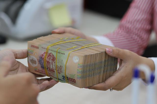 NHNN khuyến khích trích lập 100% dự phòng cụ thể với nợ cơ cấu lại - Ảnh 1.