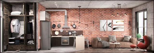 Nổi bật trên tông màu nâu xuyên suốt của ngôi nhà là bức tường gạch trần nơi phòng khách cùng những bức tranh nghệ thuật thể hiện cá tính của chủ nhà.