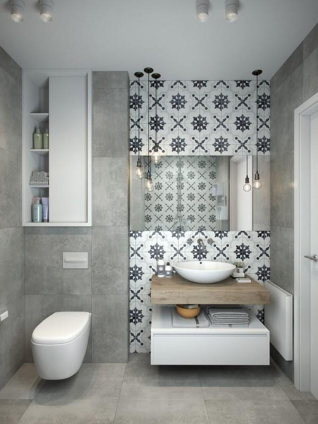 Không gian nhỏ xinh này cũng được tiến hành nhiều thủ pháp lưu trữ cho nhà chật như tủ âm tường, hệ kệ để đồ bên dưới chậu rửa.