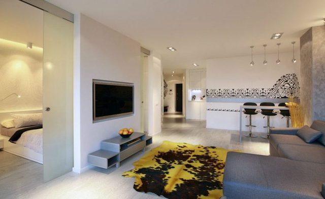 Chỉ với 54m2 nhưng căn hộ có tới 2 phòng ngủ đặt hai bên khu vực để ti vi của phòng khách.