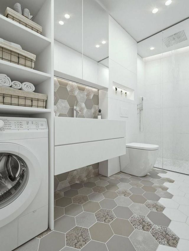 Trái ngược có phòng khách, phòng ngủ, khu vực nhà tắm lại được thiết kế chỉ toàn tông màu sáng và không hề có sự hiện diện của màu đen.
