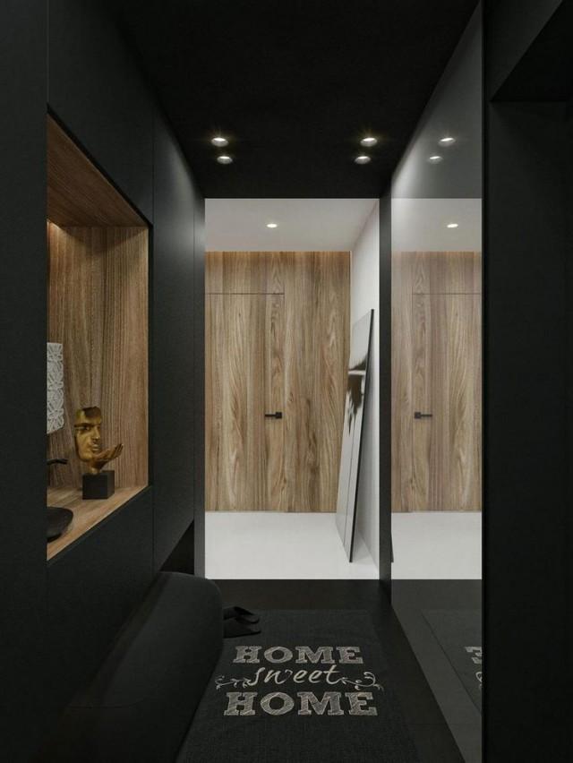 Lối vào nhà được thiết kế dễ làm có chiếc gương lớn giúp nhân đối diện tích cho góc nhỏ.