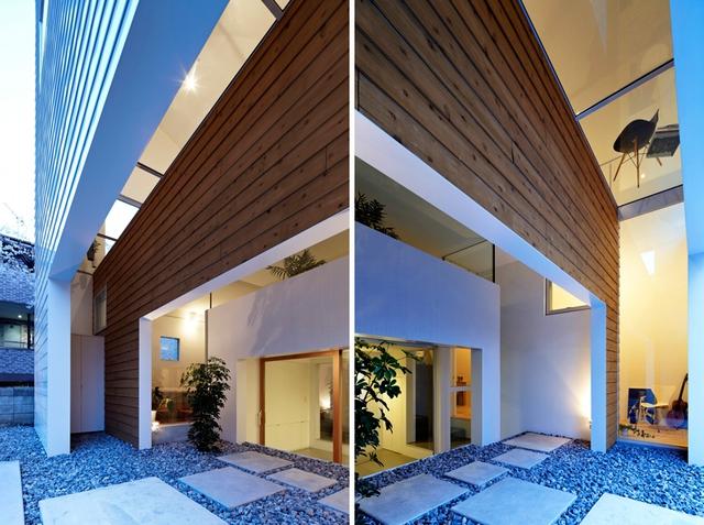 Lối vào được thiết kế ấn tượng với cây xanh cùng những phiến đá được rải sỏi đặt cách nhau một khoảng nhất định.