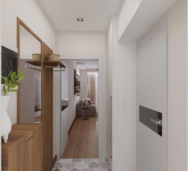 Không gian nơi đây được đặt những chiếc tủ gỗ lớn nhỏ làm nơi trữ đồ dùng cá nhân và tủ quần áo của chủ nhà.