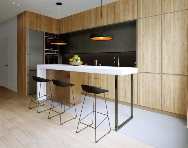 Với thiết kế độc đáo, bếp tích hợp quầy bar mang đến sự mộc mạc đầy tinh tế cho không gian ngôi nhà.