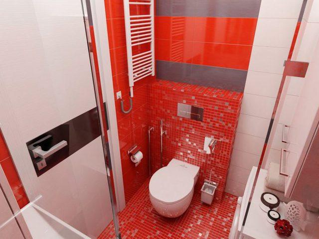 Nhà vệ sinh tuy nhỏ nhưng được thiết kế khá hiện đại và ấn tượng với tông đỏ.