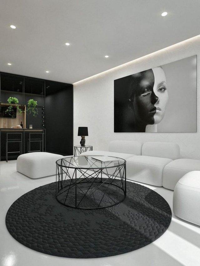 Bức chân dung lớn cũng có 2 tông màu đối lập đen- trắng lôi kéo mọi ánh nhìn của khách vào nhà.