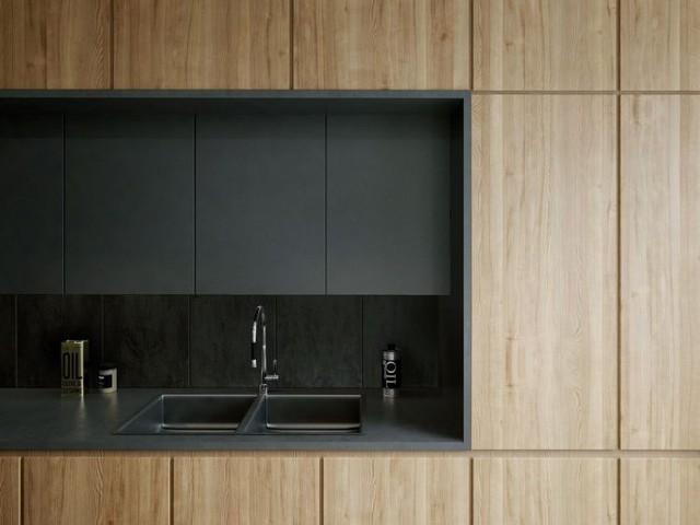 Toàn bộ khu vực bếp nấu được tích hợp trong hệ thống tủ gỗ khép kín mang đến không gian ấm cúng và sạch sẽ và tiện nghi cho nơi nấu ăn.