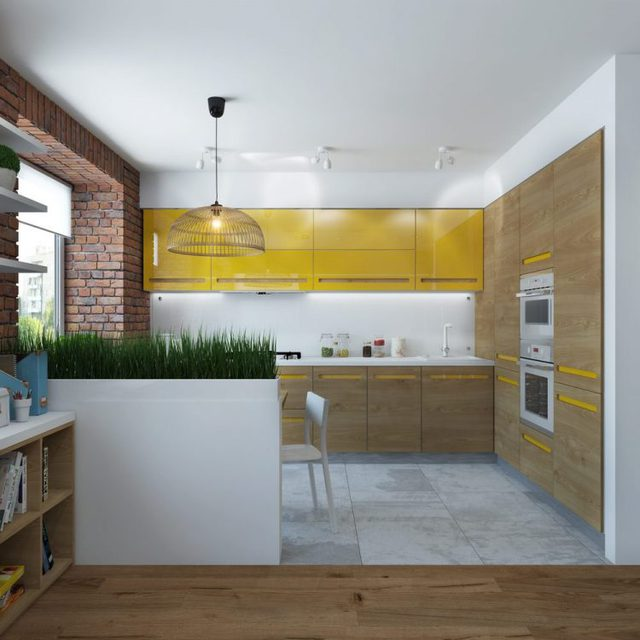 Nối liền phòng khách là bếp ăn nhỏ. Góc nhỏ này được kiến trúc nổi trội có tủ bếp màu vàng chanh trên nền bức tường trắng.