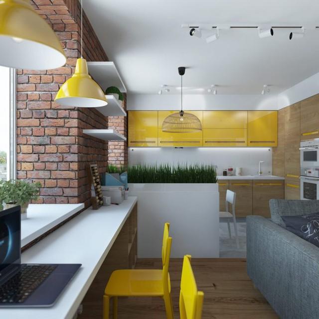 Bức tường gạch thô nối dài từ phòng khách chạy sáng khu vực bếp ăn tạo không gian vô cộng gần gũi và ấm cúng.