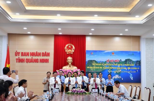 Vietcombank ký kết thỏa thuận hợp tác với UBND tỉnh Quảng Ninh và Tập đoàn FPT cung cấp dịch vụ thanh toán phí, lệ phí dịch vụ công - Ảnh 1.