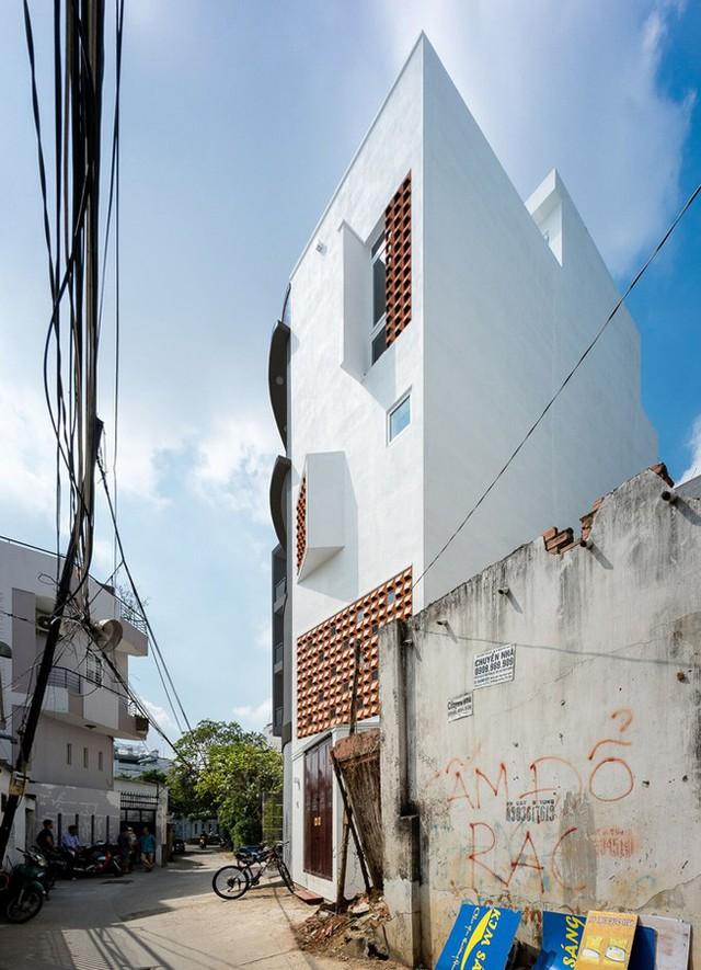 Nhà 43m2 méo mó giữa Sài Gòn xuất hiện ấn tượng trên báo Mỹ - Ảnh 1.
