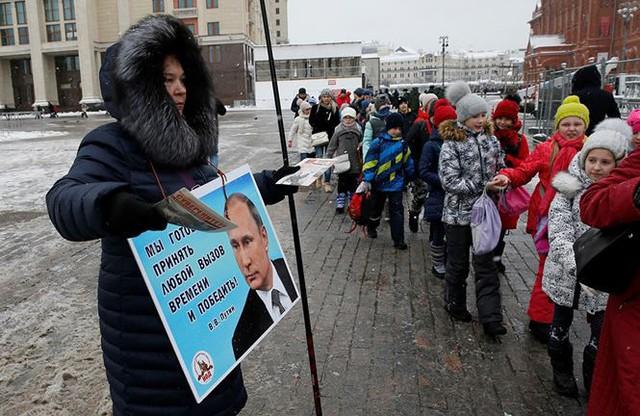 [CẬP NHẬT] 100 triệu cử tri Nga bắt đầu bỏ phiếu bầu Tổng thống - Ảnh 8.