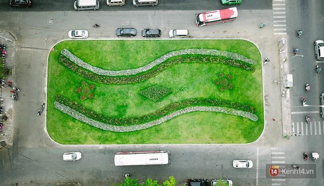 Bãi giữ xe bỏ hoang phía sau Nhà hát TP. HCM đã biến thành vườn hoa xanh ngát - Ảnh 8.