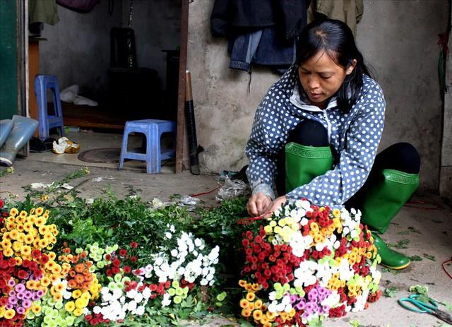 Làng hoa Tây Tựu trầm lắng dù cận ngày Quốc tế Phụ nữ 8.3 - Ảnh 10.
