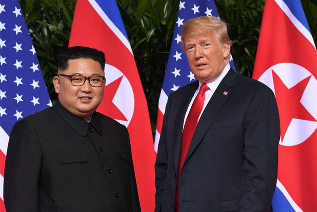 Chùm ảnh: Sự tương tác thú vị giữa Tổng thống Trump và lãnh đạo Triều Tiên Kim Jong-un - Ảnh 8.