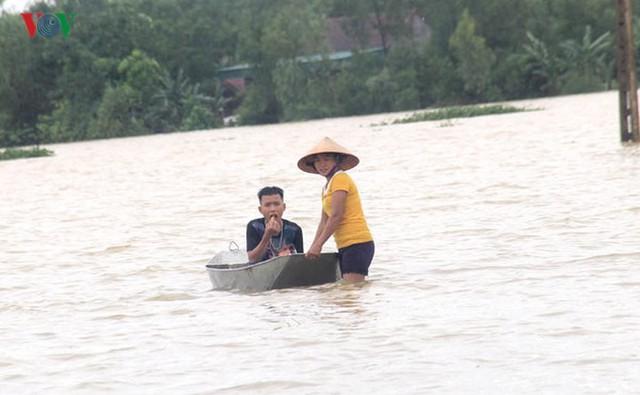 Ảnh: Bão số 3 gây mưa to, lũ lớn khiến bản làng tan hoang - Ảnh 2.