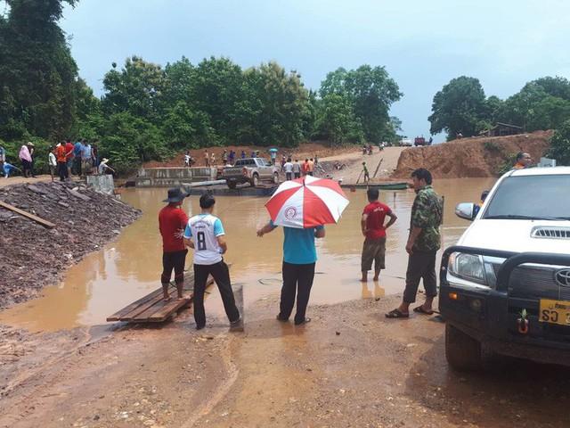 Tường thuật từ nơi vỡ đập thủy điện Lào: Chỉ còn một sốh dùng trực thăng, ca-nô để cứu người - Ảnh 8.