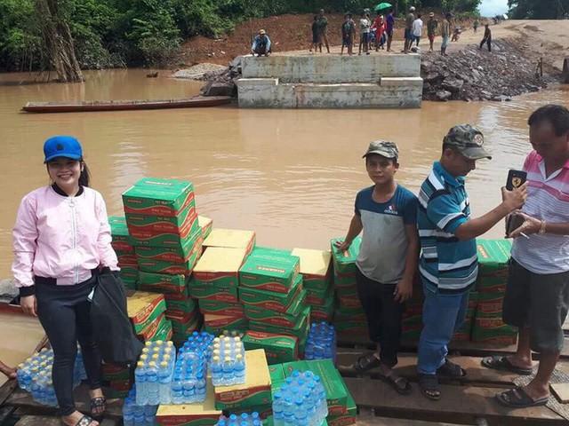 Tường thuật từ nơi vỡ đập thủy điện Lào: Chỉ còn một sốh dùng trực thăng, ca-nô để cứu người - Ảnh 9.