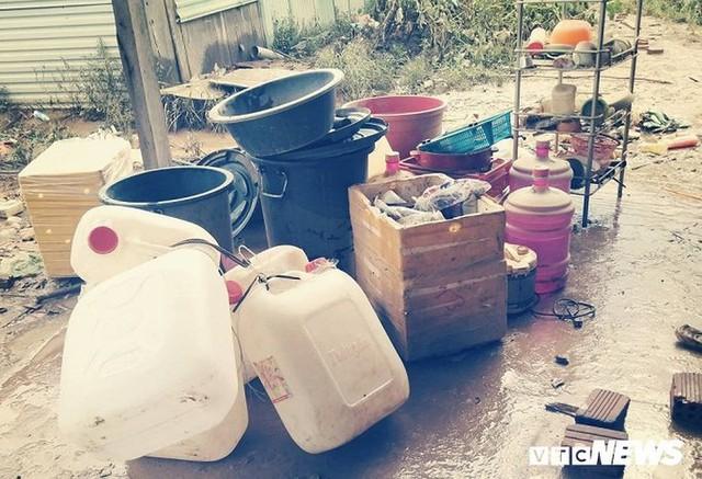 Ảnh: Người Việt thẫn thờ dọn dẹp đổ nát sau vụ vỡ đập thủy điện ở Lào - Ảnh 6.