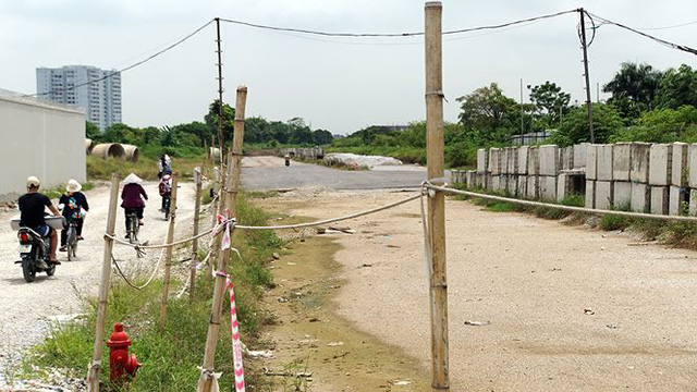 Ngổn ngang tuyến đường đổi bằng 180 ha đất vàng ở Hà Nội   - Ảnh 6.