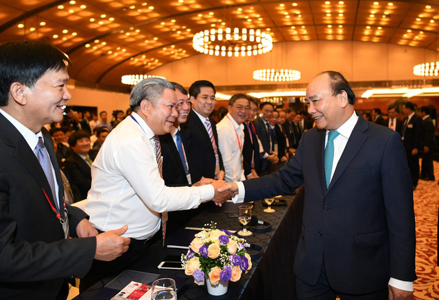 Thủ tướng Nguyễn Xuân Phúc: Trong cuộc chơi toàn cầu hóa, khi Việt Nam tiến lên, các nước khác cũng đang tiến lên - Ảnh 1.