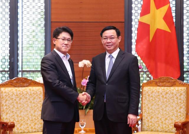Phó Thủ tướng đề nghị HSBC hỗ trợ trong việc xử lý nợ xấu, tái cơ cấu 1 số định chế tài chính - Ảnh 2.