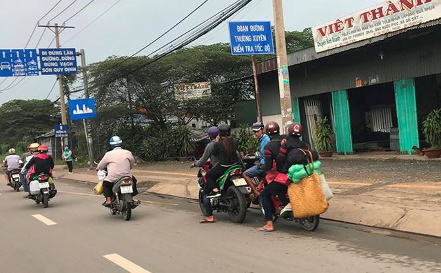 Người dân ùn ùn trở lại Sài Gòn sau lễ - Ảnh 16.