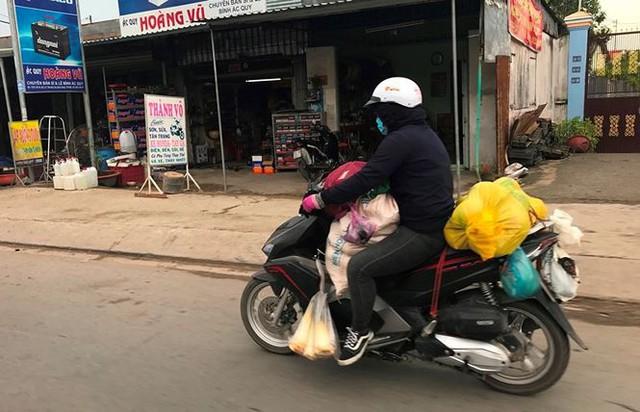 Người dân ùn ùn trở lại Sài Gòn sau lễ - Ảnh 18.