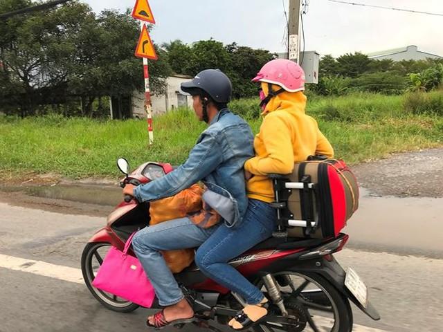 Người dân ùn ùn trở lại Sài Gòn sau lễ - Ảnh 22.