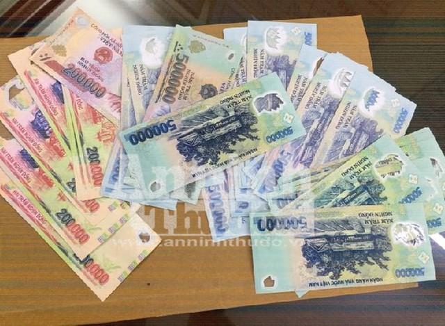 Cảnh sát hình sự Hà Nội triệt phá đường dây dùng tiền giả mua điện thoại di động - Ảnh 2.