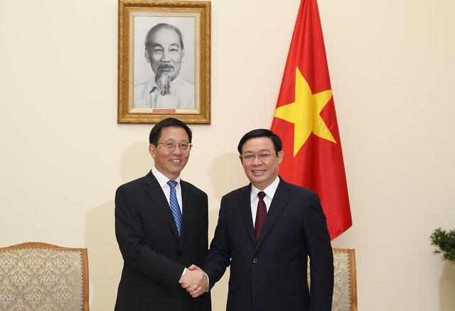 Phó Thủ tướng Vương Đình Huệ đề nghị phía Trung Quốc khơi thông nông sản xuất khẩu từ Việt Nam - Ảnh 1.