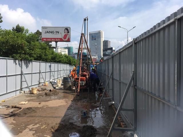 Rào đường để cứu rốn ngập Nguyễn Hữu Cảnh - Ảnh 5.