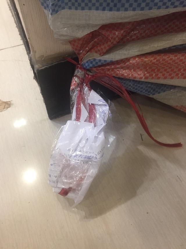 Vụ Seven.AM bị tố cắt mác Trung Quốc: Tạm giữ hơn 9.000 sản phẩm để điều tra, làm rõ - Ảnh 2.